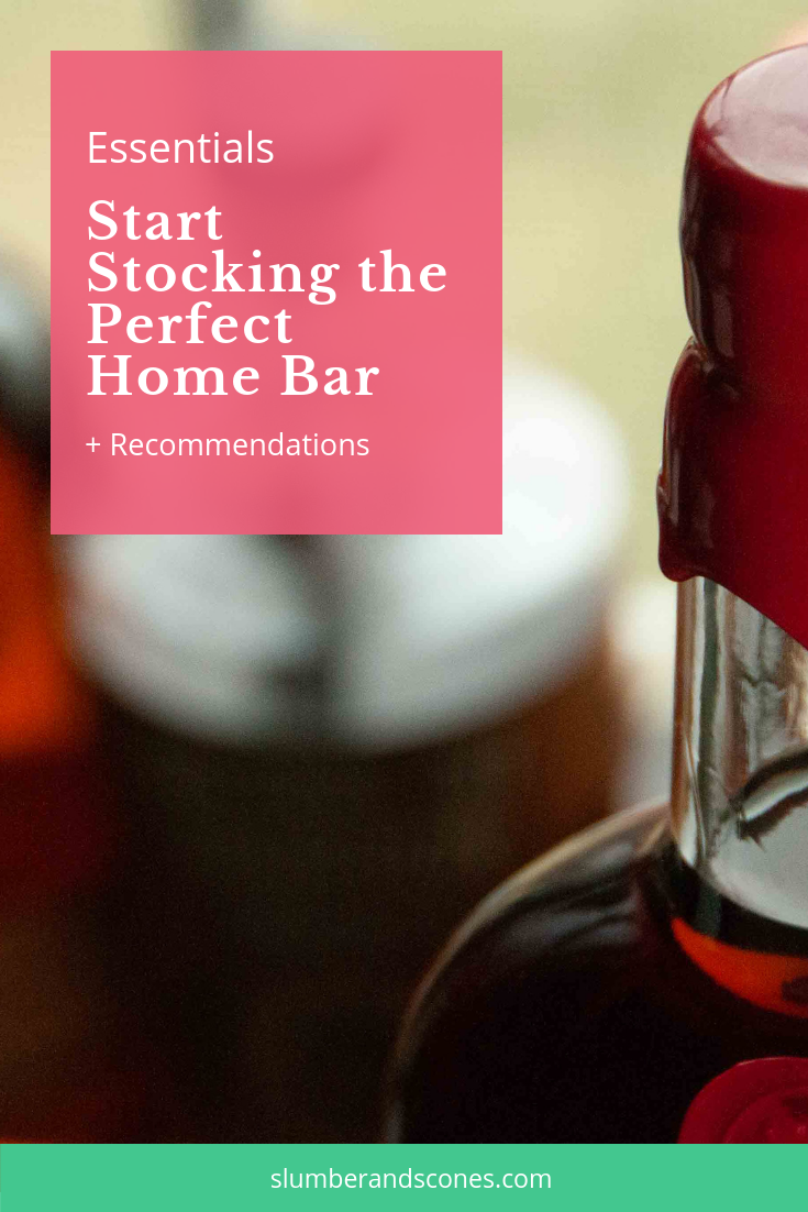 pinterest image for the essential liquor for your home bar